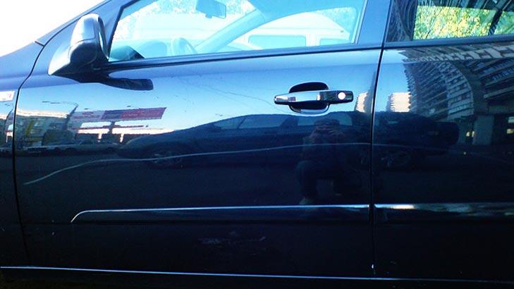 Царапина на кузове автомобиля